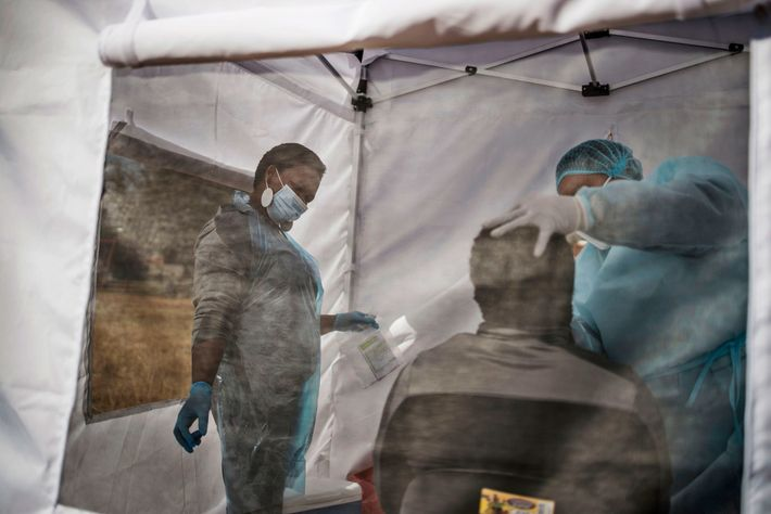 A man is tested for the novel coronavirus, COVID-19, in Vrededorp, Johannesburg, on June 5, 2020. ...