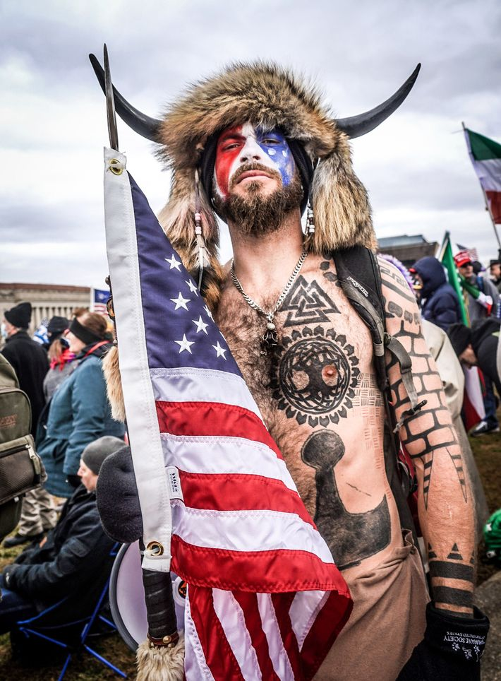 "Jake Angeli, the self-styled ""QAnon Shaman,"" is tattooed with Norse and Viking symbols that, in a ..."