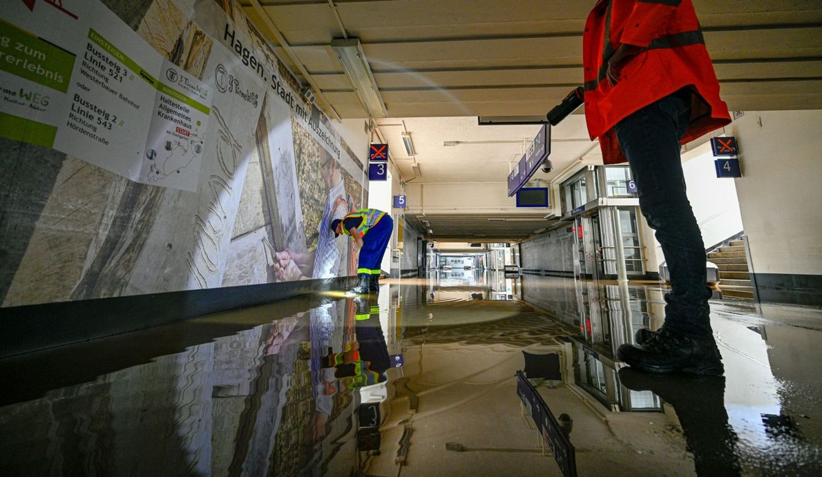 A member of the THW (Federal Agency for Technical Relief) works to clear a flooded underpass ...