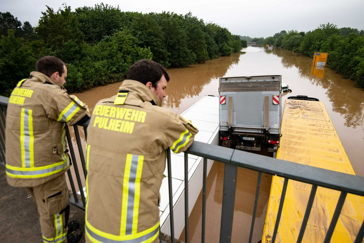 In Erftstadt, Germany, trucks are wedged together after flash floods took control of nearby vehicles.