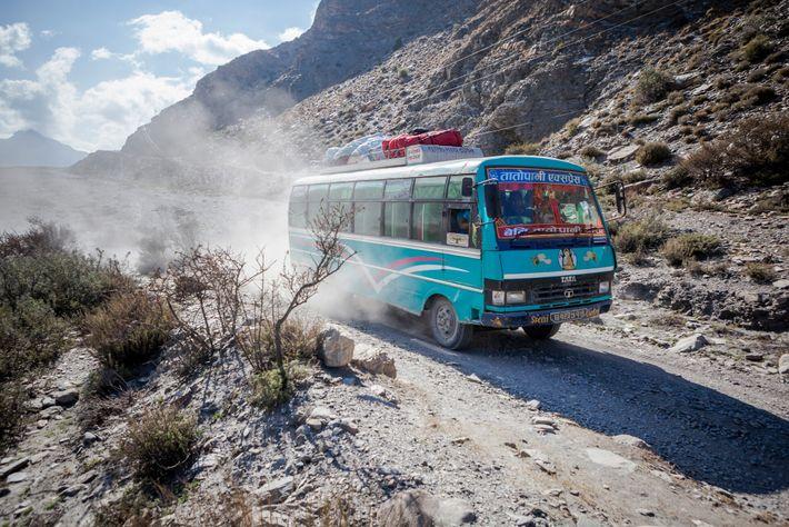 A bus heads up the dusty road along the Kali Gandaki River, between Mustang and Kathmandu.