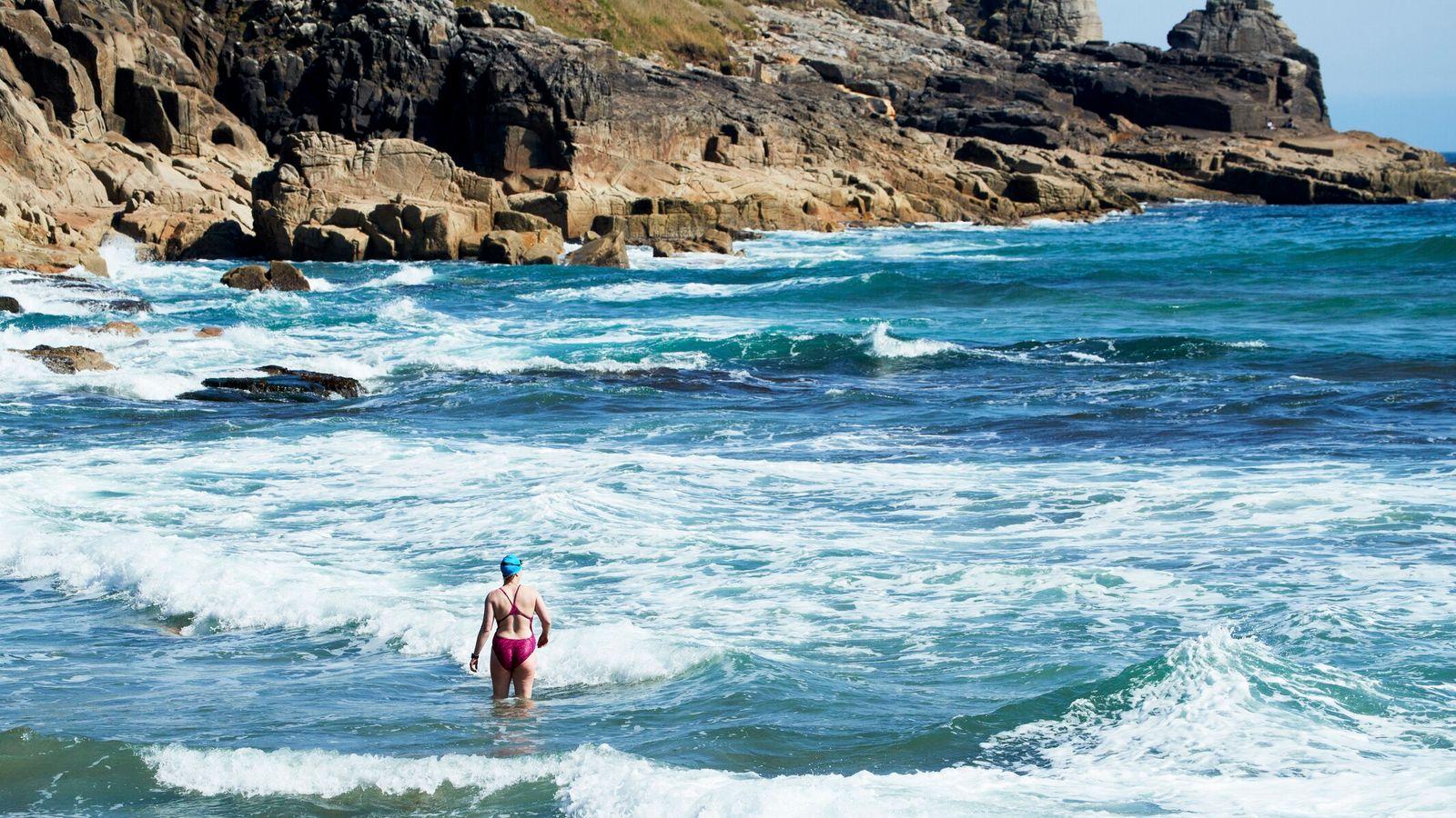 Cornwall, Gunwalloe, Church Cove, woman swimmer in the sea