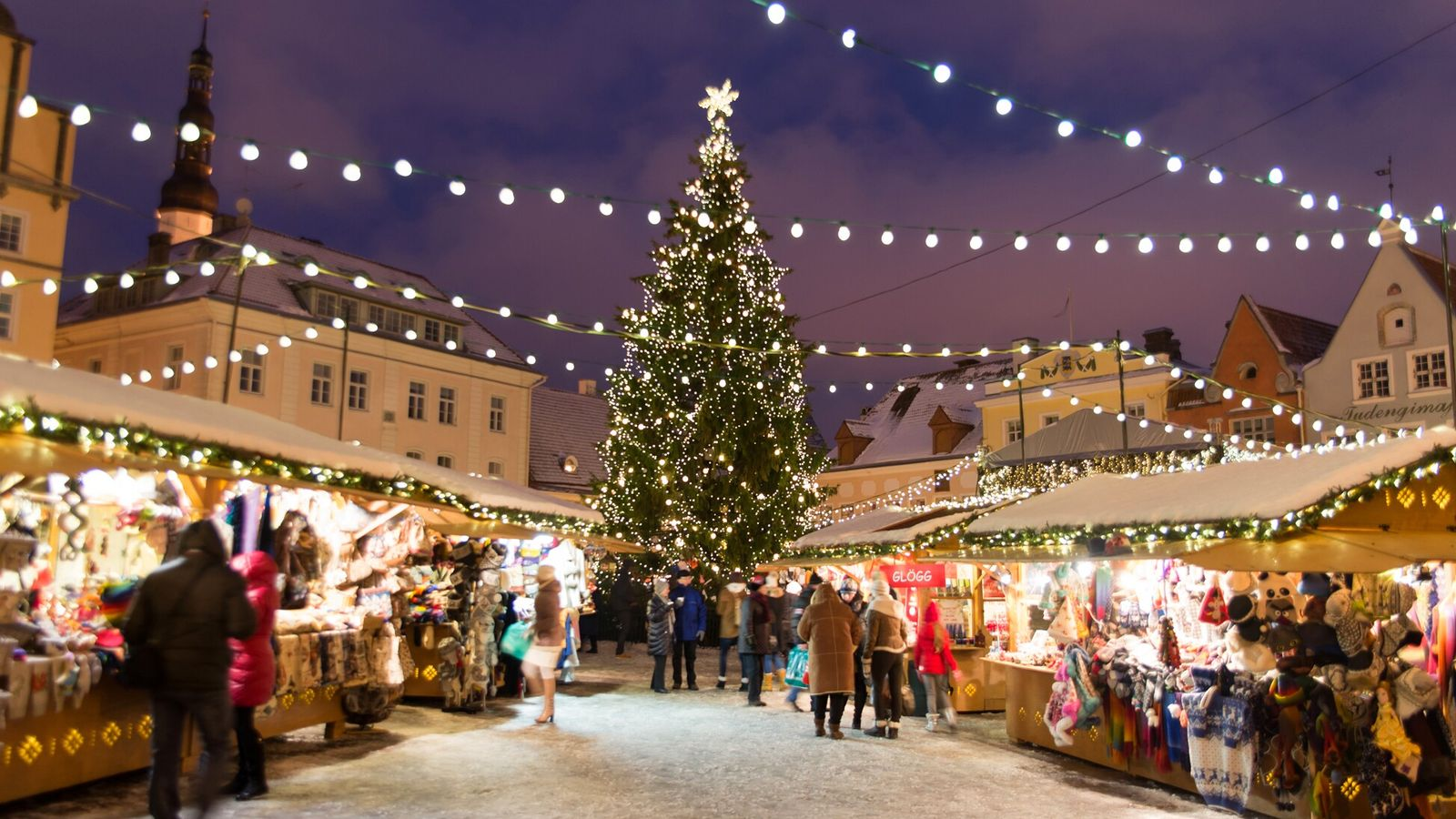 A holiday market in Estonia's capital Tallinn features a large Christmas tree. Both Latvia and Estonia ...