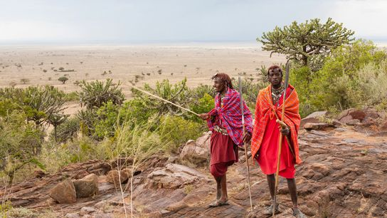 Maasai warriors, who traditionallylive in and around the country's game parks, carry spears and shorts swords ...
