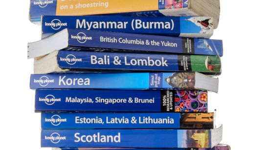 Stack of Lonely Planet guide books