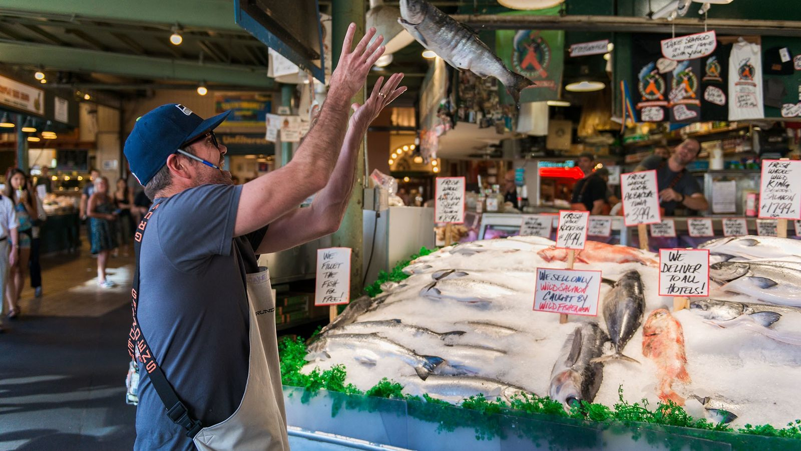 People travel from all over to USA's Washington State to see the famous Pike Place fish throwers ...