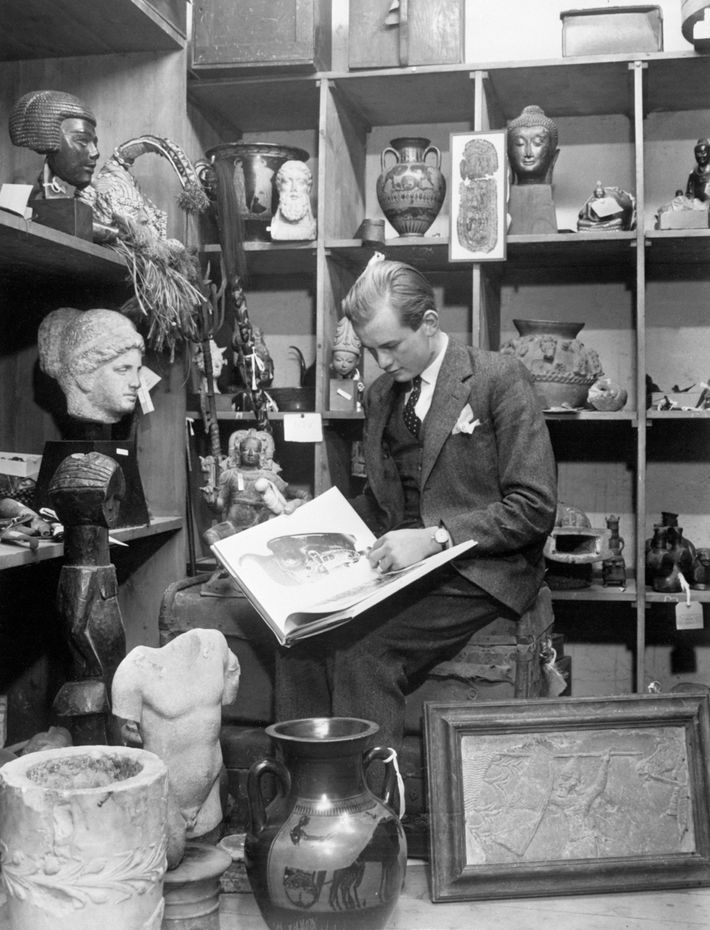In this photo taken on Christmas Eve 1960, a 20-year-old Bruce Chatwin examines antiques in Sotheby's ...