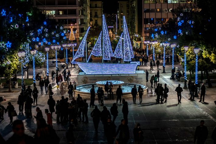 Syntagma Square features a ship decorated with lights at Christmas time in Athens, Greece.