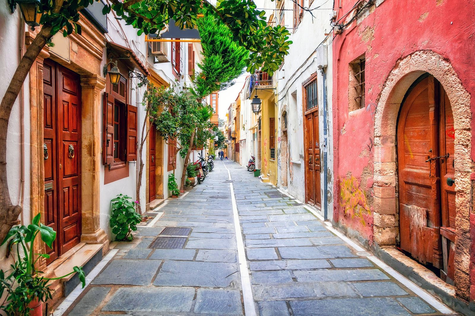 Rethymnon is known for its pastel-hued houses and Venetian harbour, where boats bob and fishermen bring ...