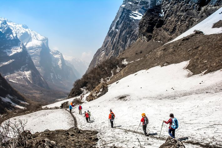 Trekkers descend from the Annapurna Base Camp in central Nepal.