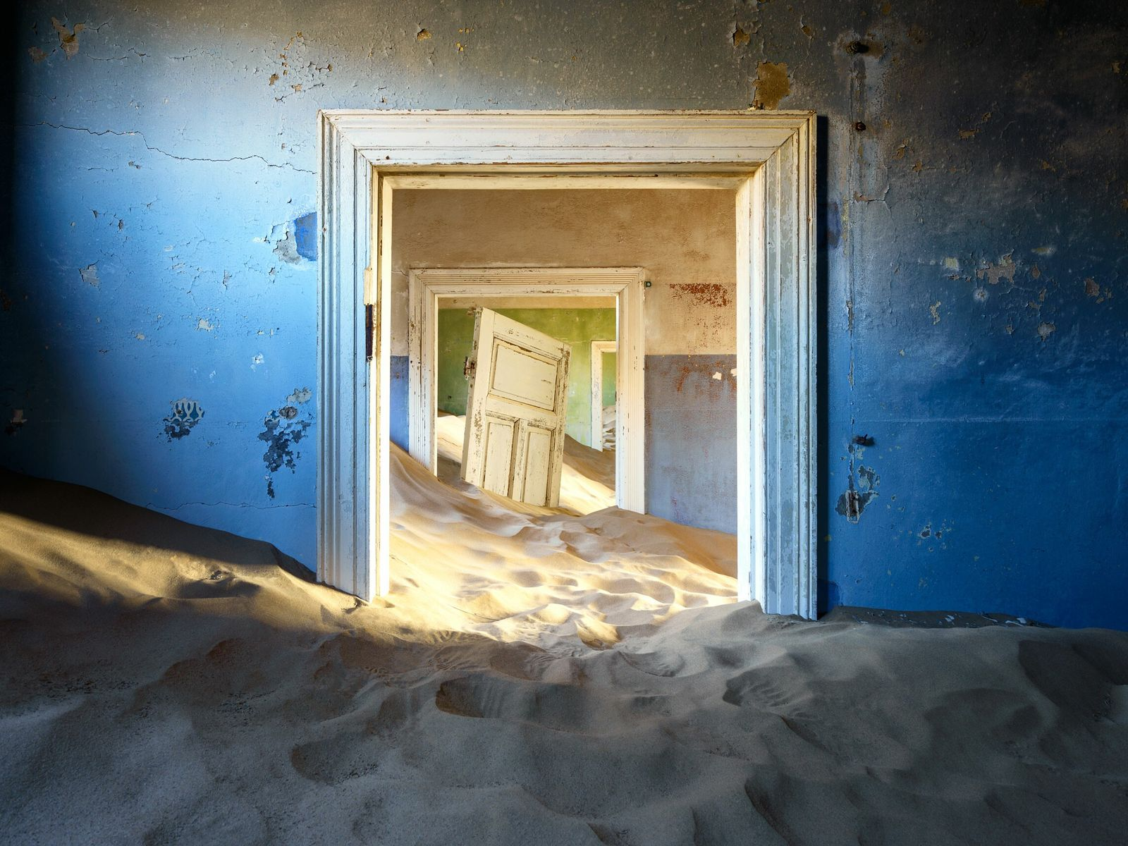 Kolmanskop, in the Namib Desert, is a diamond mining town that has been drowned in sand ...