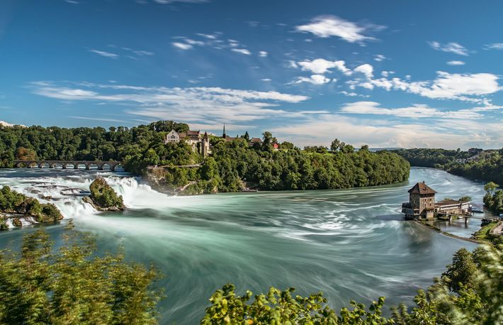 Take a 40-minute train to Schaffhausen to witness The Rhine Falls thunder, Europe's largest plain waterfall.