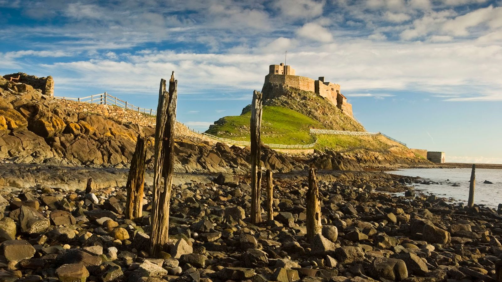The Holy Island of Lindisfarne is cut off from the Northumberland mainland by high tides for ...