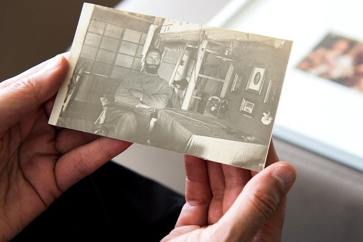 Susanne Hake holds a photo of her grandfather, Hermann Hake, pictured while he was a prisoner ...