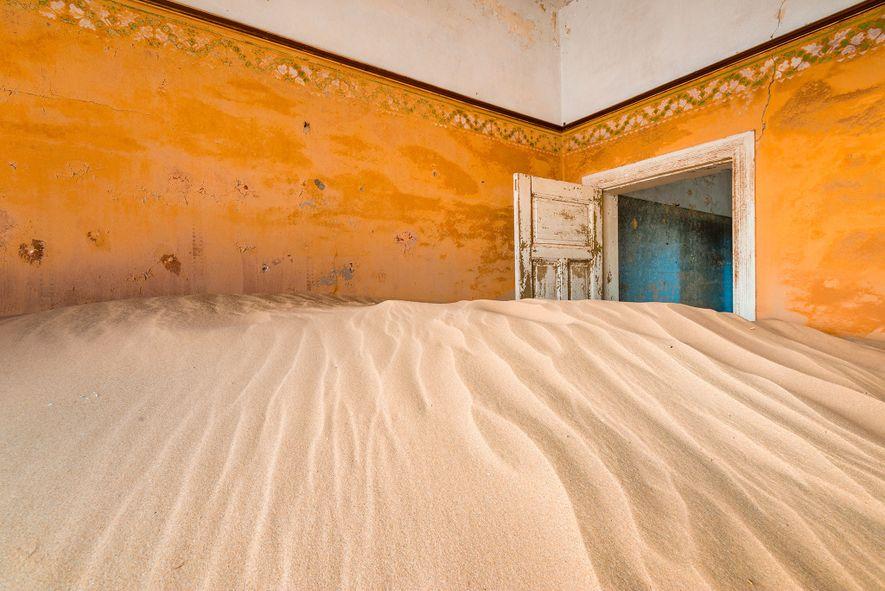 KOLMANSKOP, NAMIBIA  Located among the sand dunes of the Namib Desert, Kolmanskop was built to ...