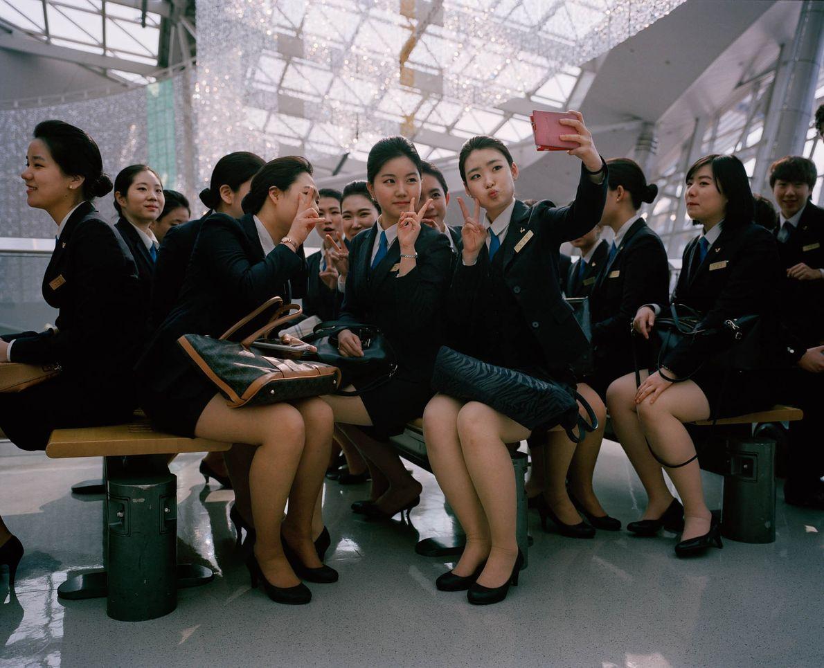 Flight attendants pose for selfies in New Songdo, South Korea.