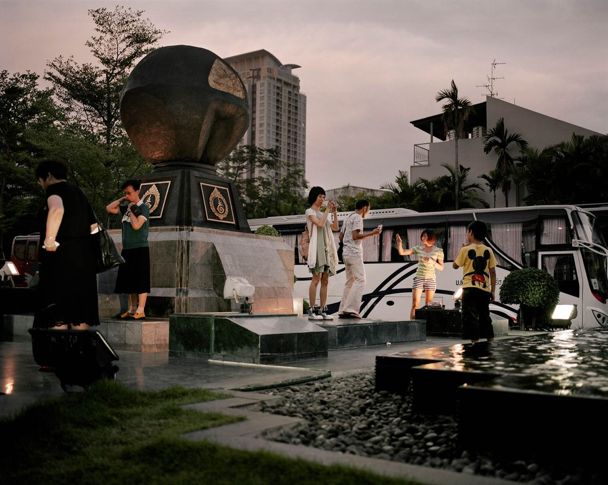 Tourists from China visit developments in downtown Bangkok. The two-story retail store offers a wide range ...