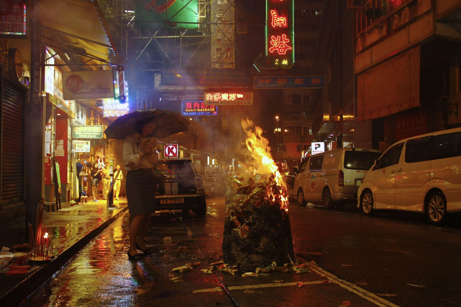 In Hong Kong, paper offerings – including 'hell money' are burned in special receptacles to pacify ...