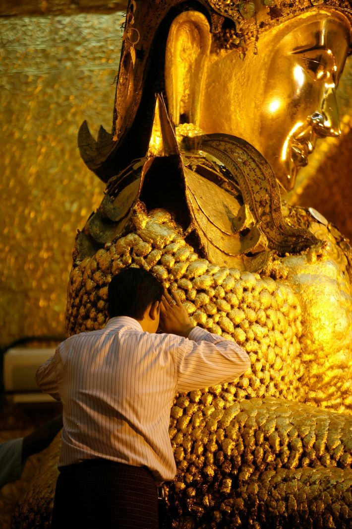Some of the King Galon workshop's gold leaf ends up on the 12-foot-tall, six-ton Buddha statue ...