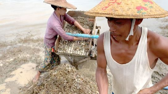 Do Toe, left, and Than Ngwe prospect for crumbs of gold along the Chindwin River in ...