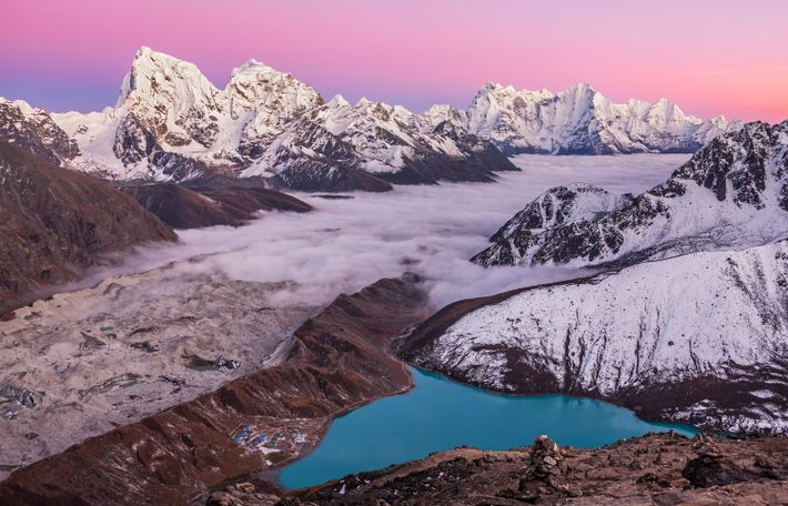 A hike to Gokyo Ri will take you over 17,000 feet above the Himalaya. Above lakes ...