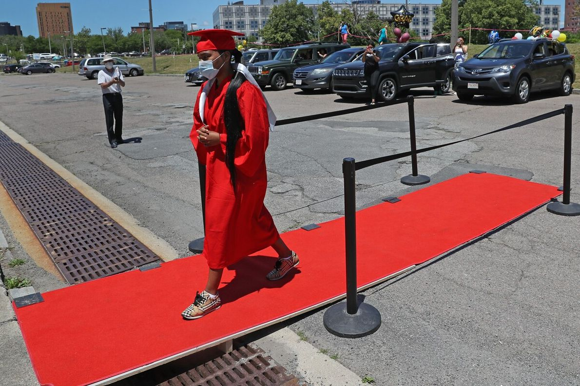Nya Rhane Christian Sena walks down a makeshift red carpet in the parking of of Madison ...
