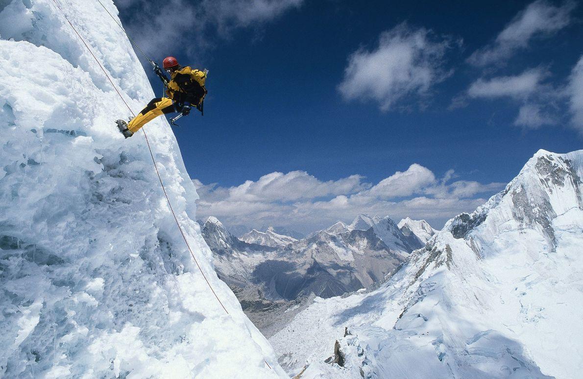 The stunning pyramidal peak of Alpamayo rises among several tropical-zone glaciers in the Cordillera Blanc mountain ...