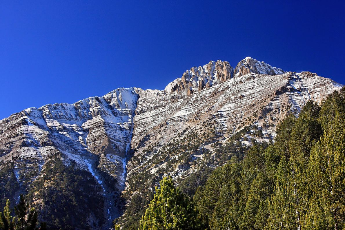 Although Mount Olympus is snowcapped and often covered in clouds, Homer's Odyssey depicted the peak as ...