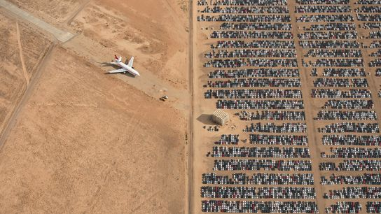 The grand-prize winning photo, seen here, pictures thousands of Volkswagen and Audi cars sitting idle in ...