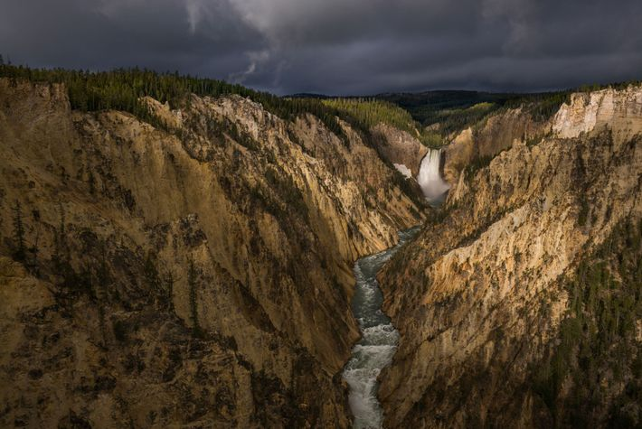 Photographs and paintings of sights such as this—the Grand Canyon of the Yellowstone— inspired Congress to ...