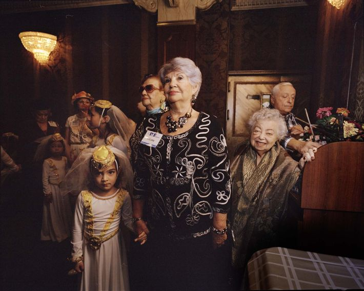 Contestant Lina Sapelnikova (centre) and honourary contestant, 92-year-old Etya Mikhelson (at right), wait to be brought ...