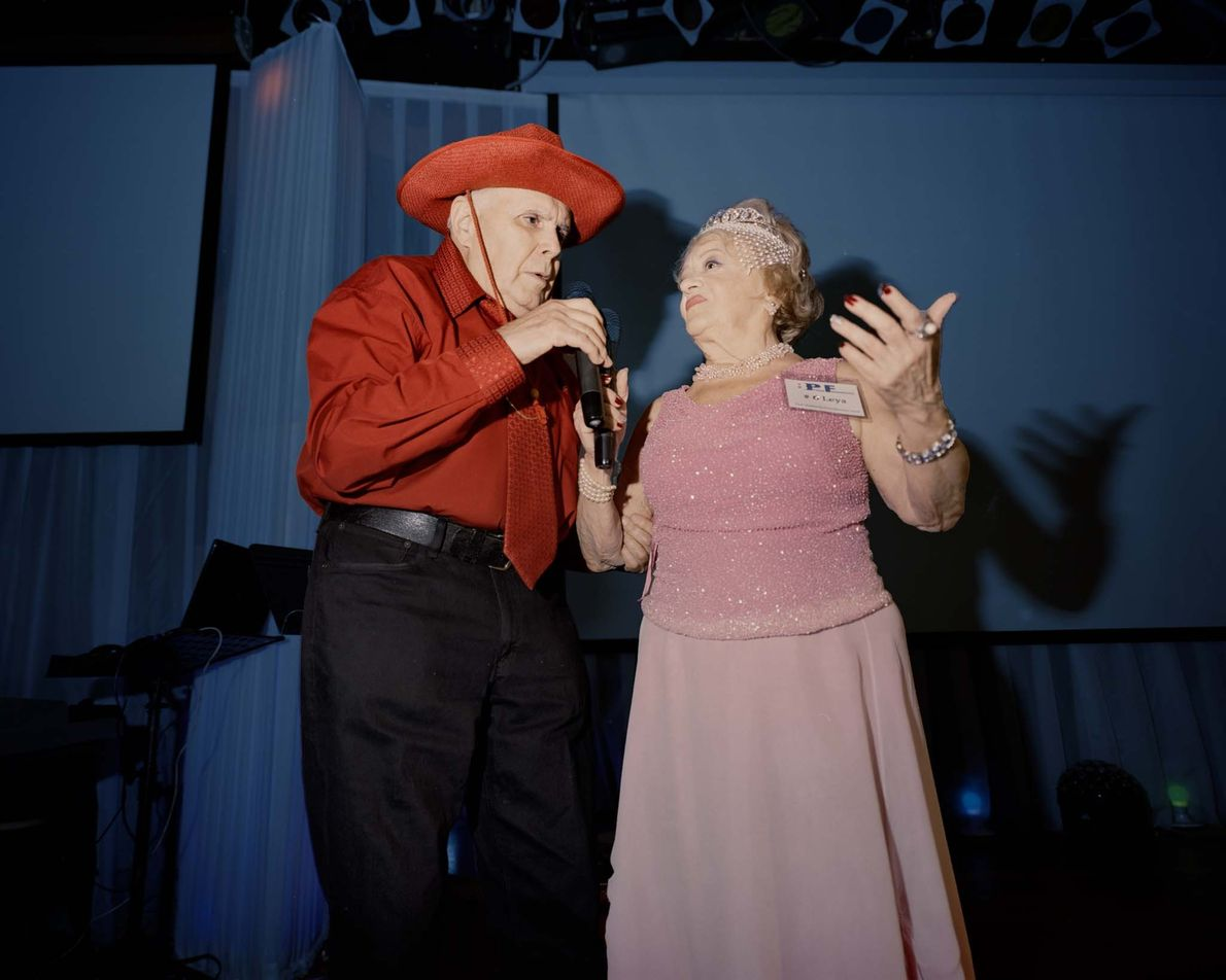 A grandmother performs a contest challenge—a song from her youth–with her husband. Photographer Yurenev said their ...