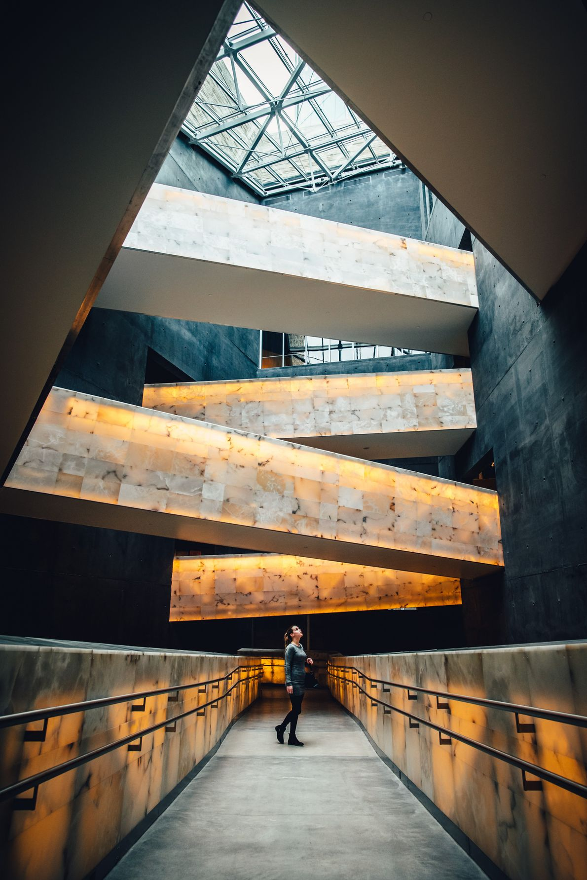 Visitors to the Canadian Museum of Human Rights are led through the Great Hall, then a ...
