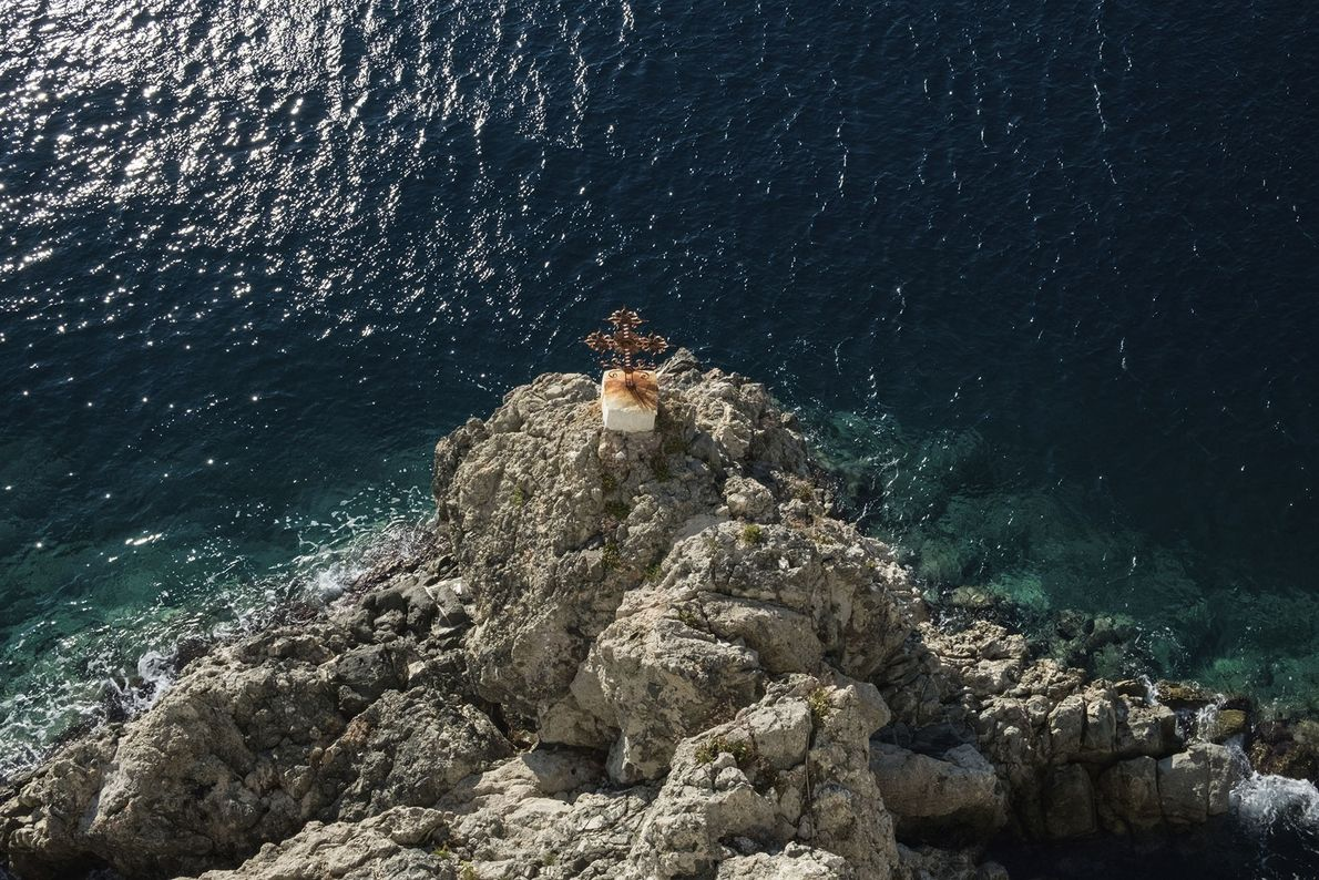 Looking down the cliff from Osiou Grigoriou Monastery on the southwest side of the Mount Athos ...