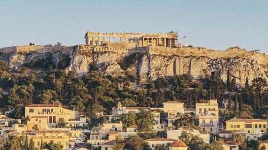 The view towards the Parthenon from Monastiraki Square, with Tzistarakis Mosque in the foreground, Athens.
