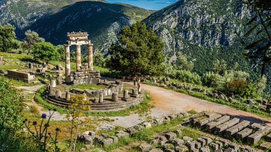 The ruins of the Tholos of Delphi, now part of the Delphi UNESCO World Heritage Site. ...