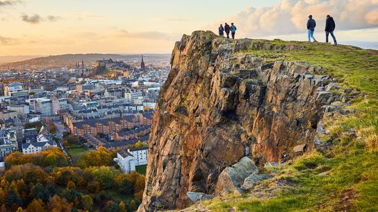Walkers overlooking the city of Edinburgh