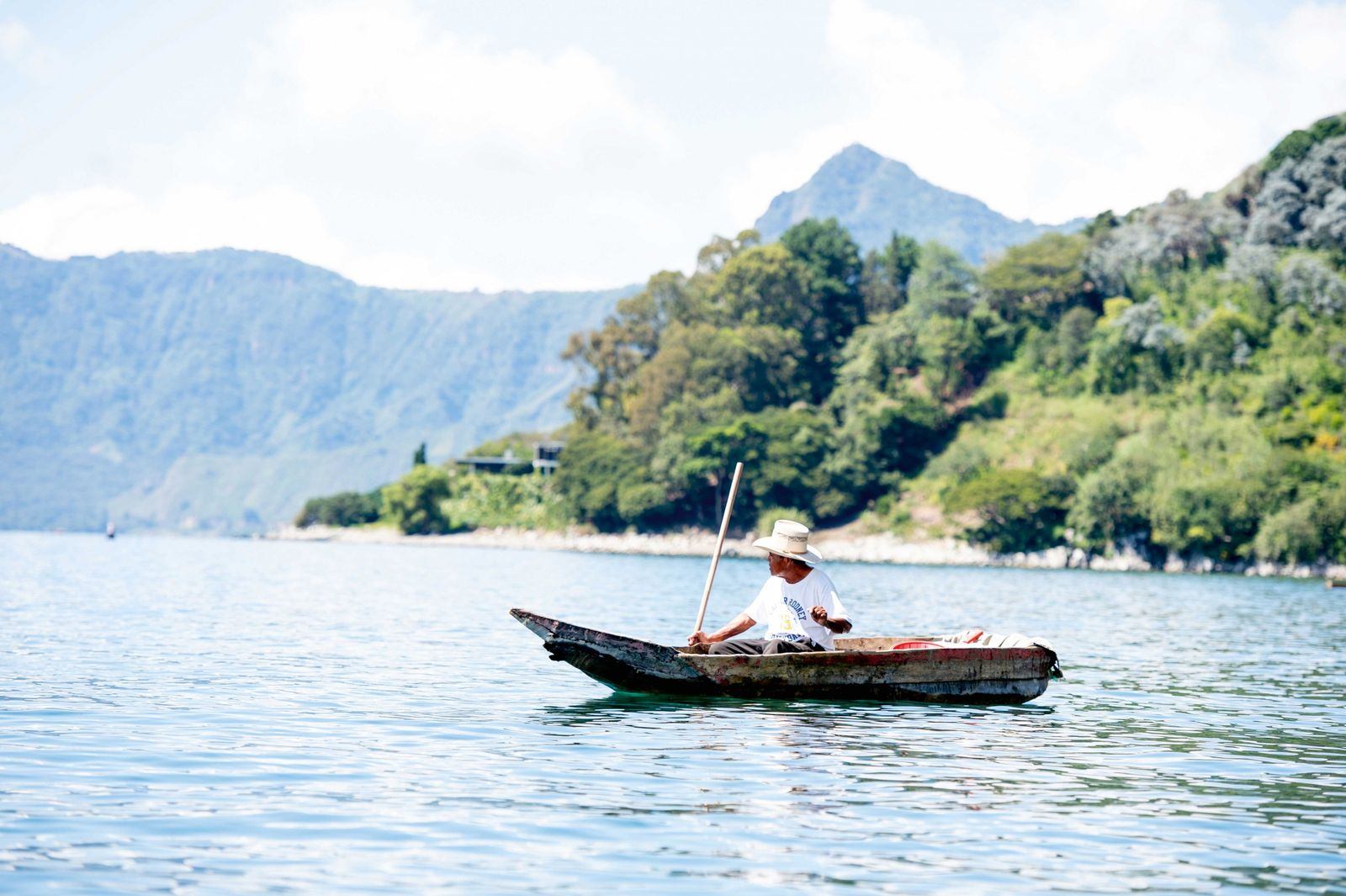A fisherman in a traditional canoe, Lake Atitlán.