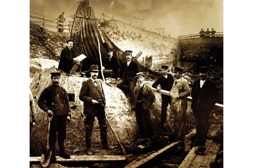 Alerted to the presence of Viking remains at Oseberg in summer 1903, Professor Gustafson (centre) traveled ...