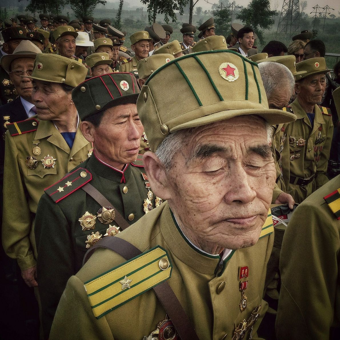 North Korean veterans of the Korean War enter a cemetery for Korean War veterans during an ...
