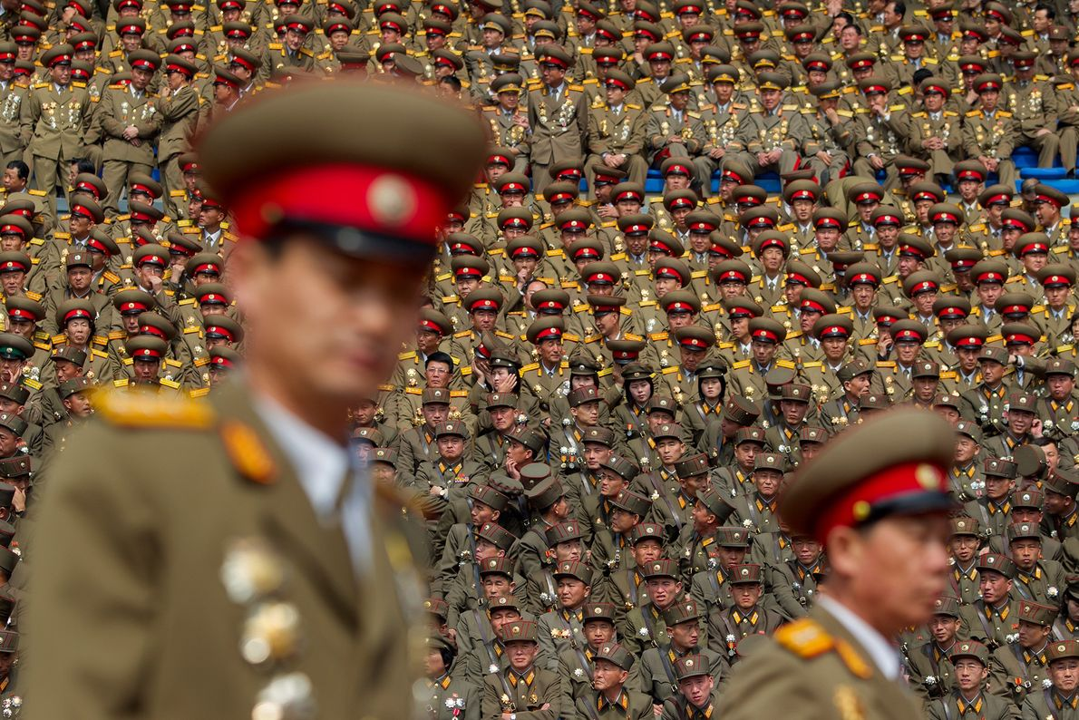 Members of North Korea's military pack a stadium in Pyongyang in 2012 during celebrations honoring North ...