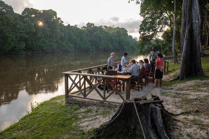 A riverside breakfast at Rewa Eco-Lodge.