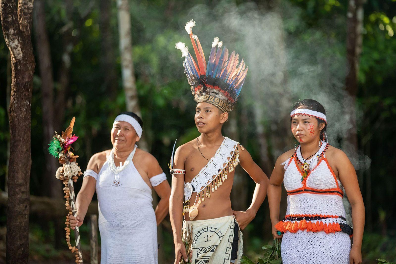 Amerindian villagers demonstrating traditional ways  of life at Makushi Cultural Village.