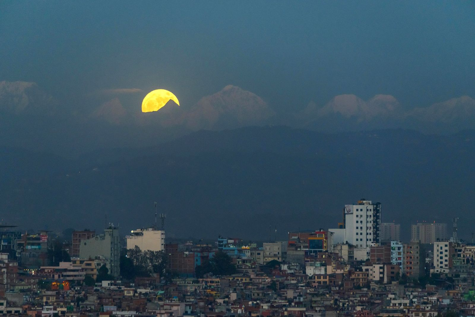 A supermoon rises over the Kathmandu suburb of Patan – beyond which the world's highest mountains rise. ...