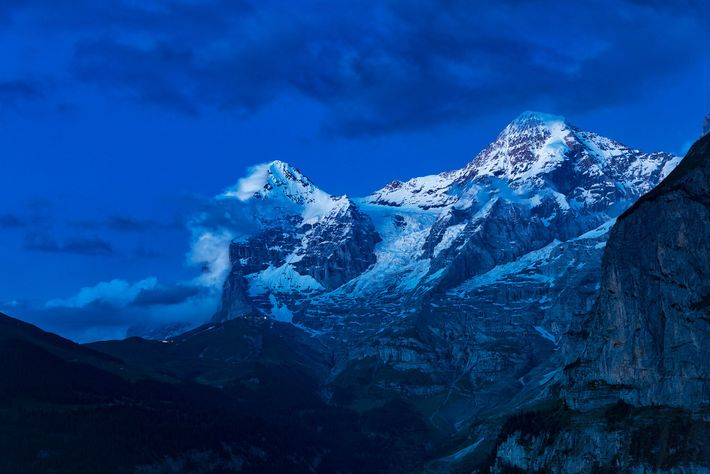 The 13,015-foot Eiger (left) and the 13,474-foot Mönch are two of the most imposing peaks in ...