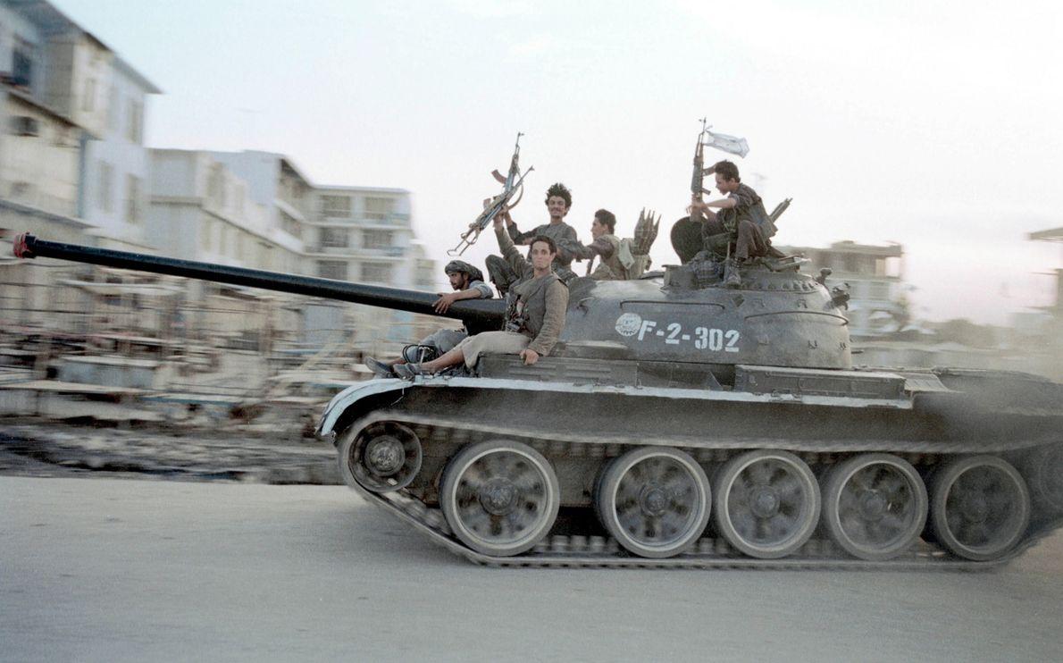 Taliban soldiers drive Soviet tank