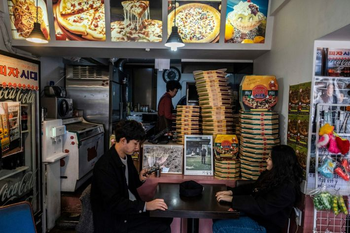 """People visit Sky Pizza, a restaurant in Seoul, South Korea that appears in the film """"Parasite,"""" ..."""