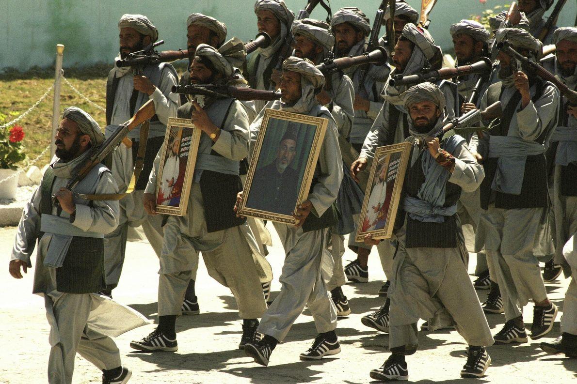 Mujahidin parade with Massoud and Karzai portraits