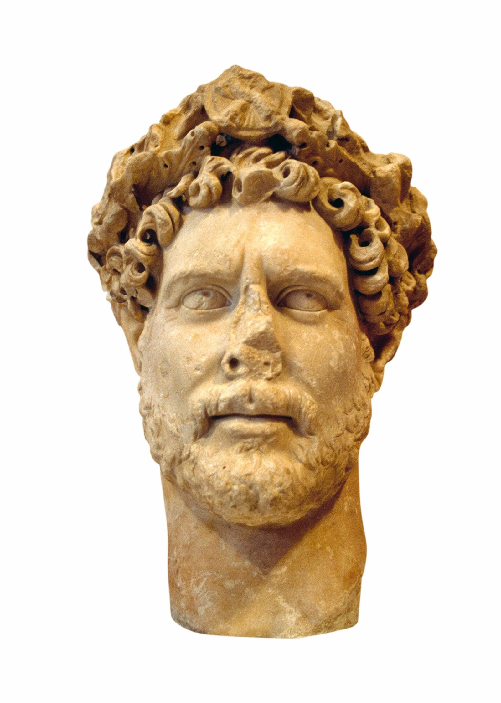 In life, Hadrian sported a Greek-style haircut and beard, reflected in this marble bust from A.D. ...