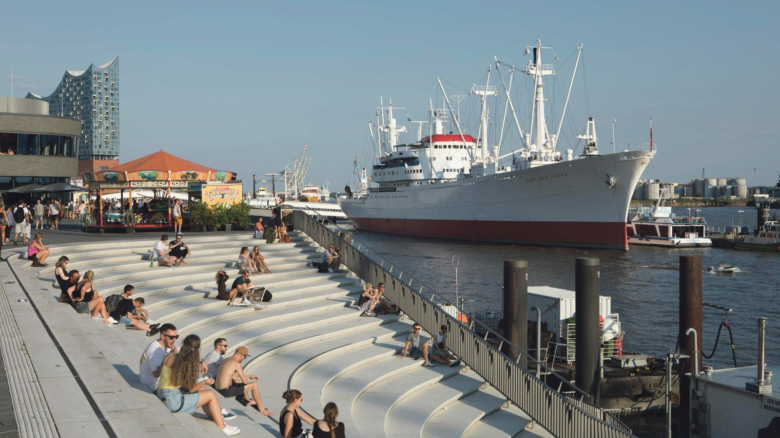 Hamburg's port, on the banks of the Elbe, welcomes the biggest ships on Earth via the ...